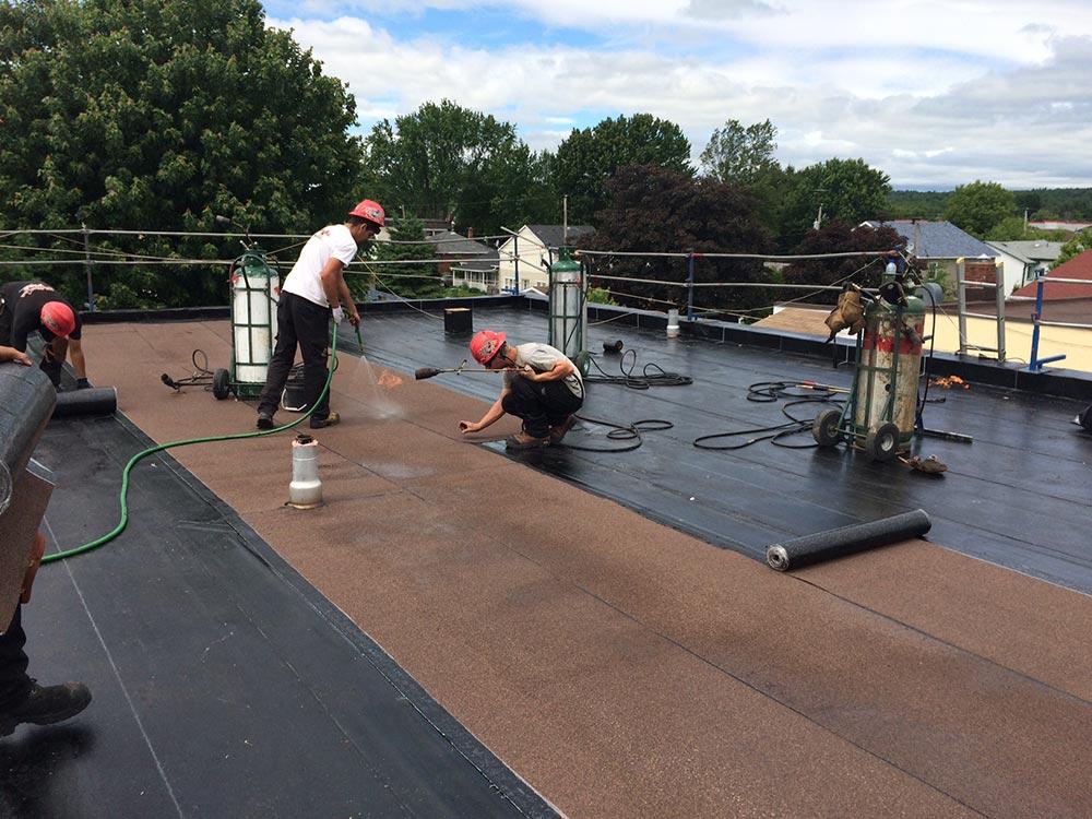 Travaux de toitures en membrane élastomère